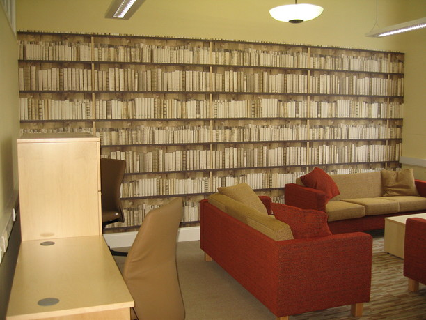 Watford Borough Council members room with sofas and book wall paper