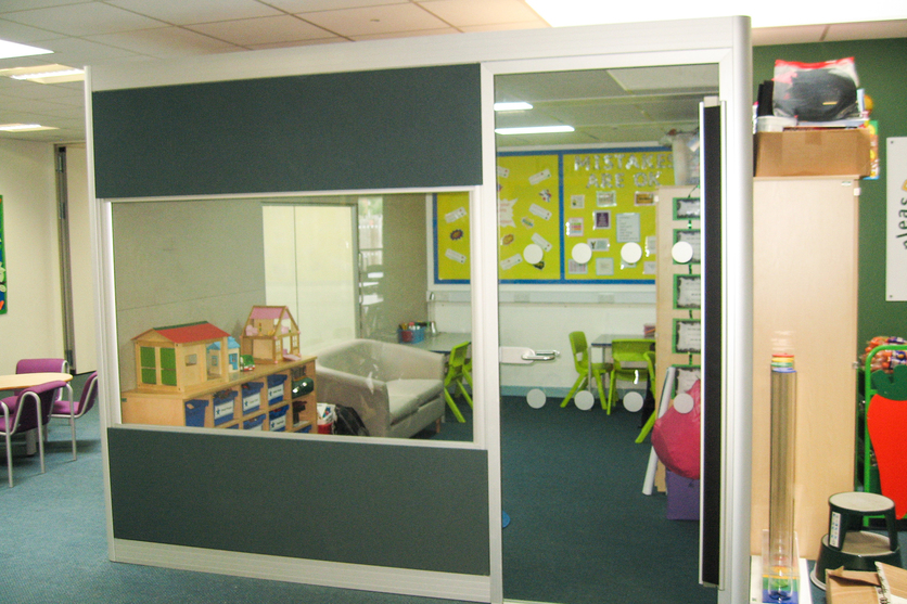 Looking into the classsroom with door open and finger safety panel on door