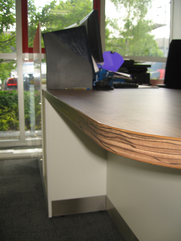 Close up of reception counter, Cordoba Olive top on white base