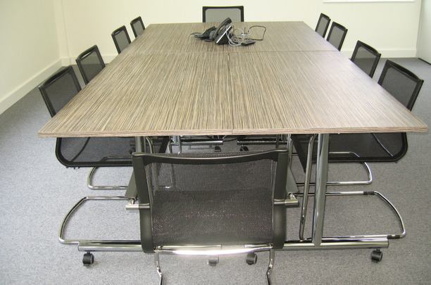 Flip top tables with mesh cantilever chairs