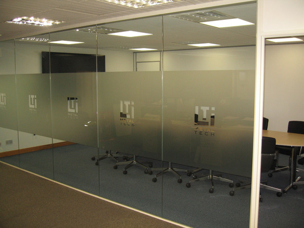 LTi Metaltech logo etched onto manifestation on boardroom glass partition