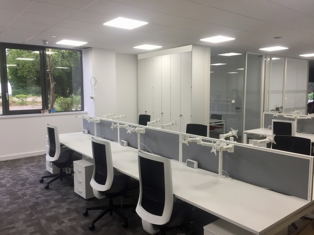 Bench desks with mesh chairs, monitor arms and desk power