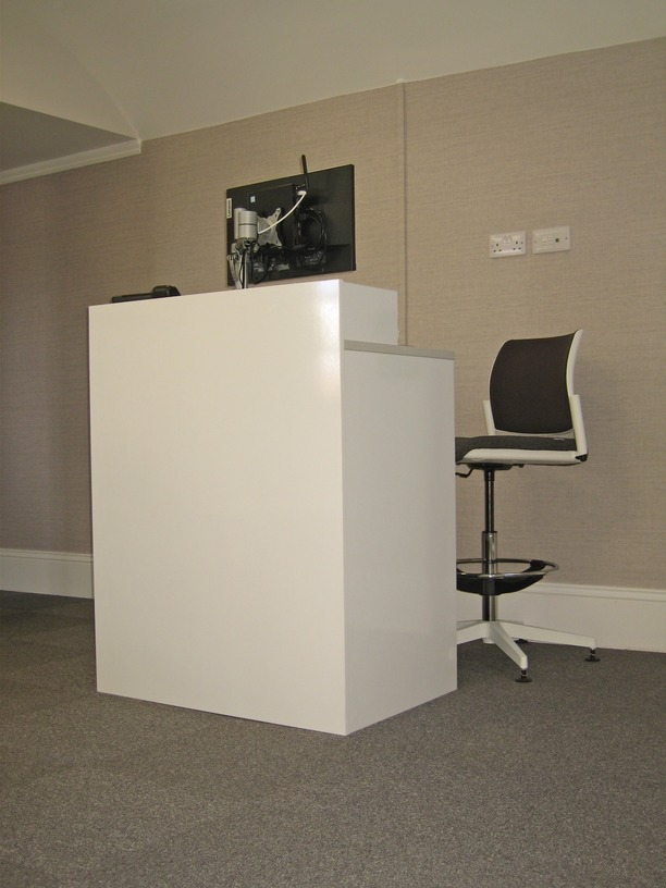 compact reception pod with tall chair