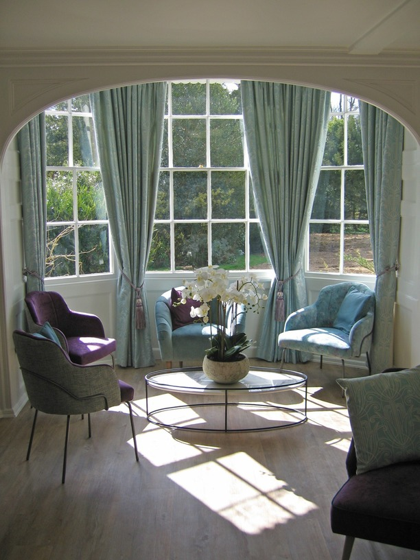 Reception seating and coffee table in bay window