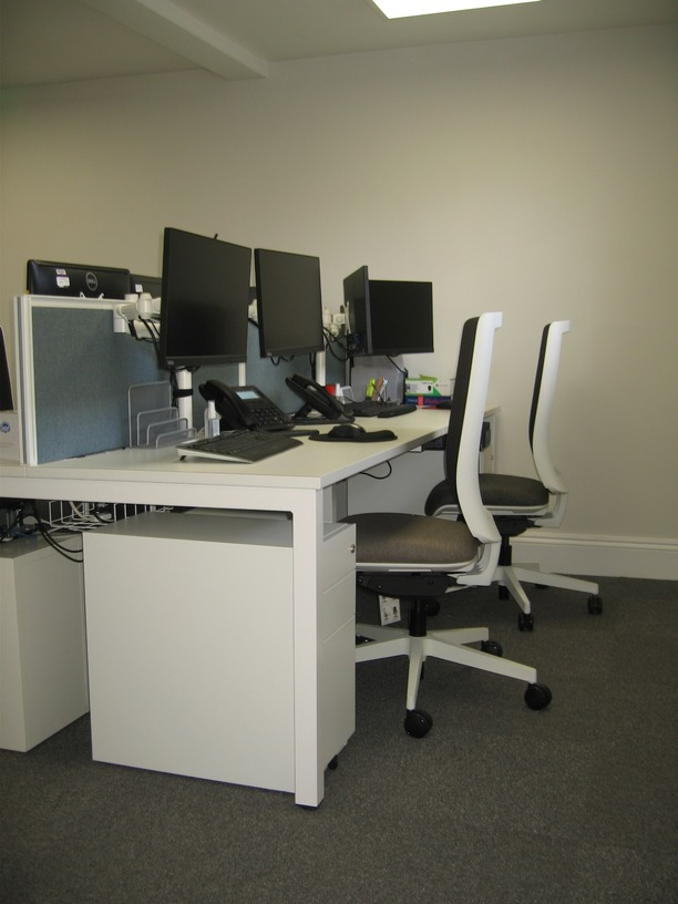 Bench desks with mesh back VDU chairs