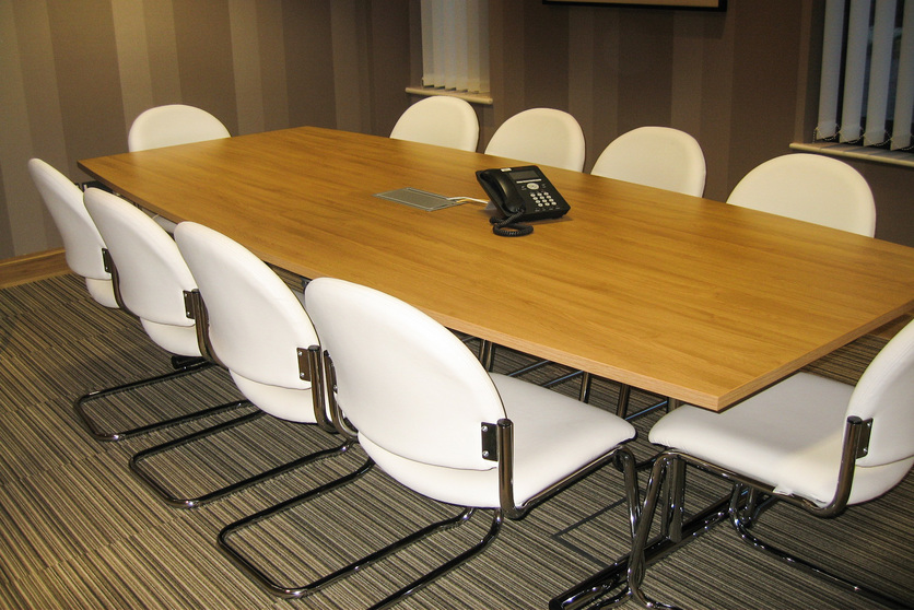 Barrel shaped meeting table with cantilever chairs