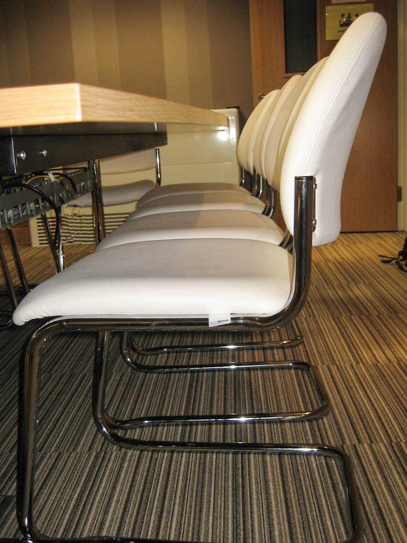 Chrome cantilever chairs with faux leather finish