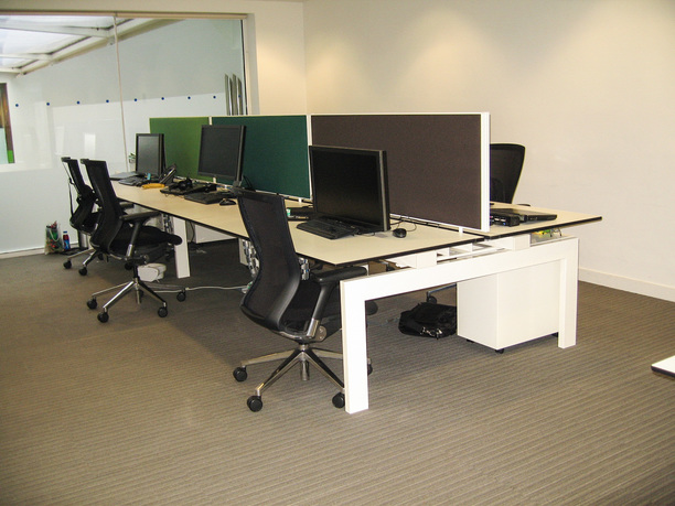 Tripadvisor bench desks with acoustic screens