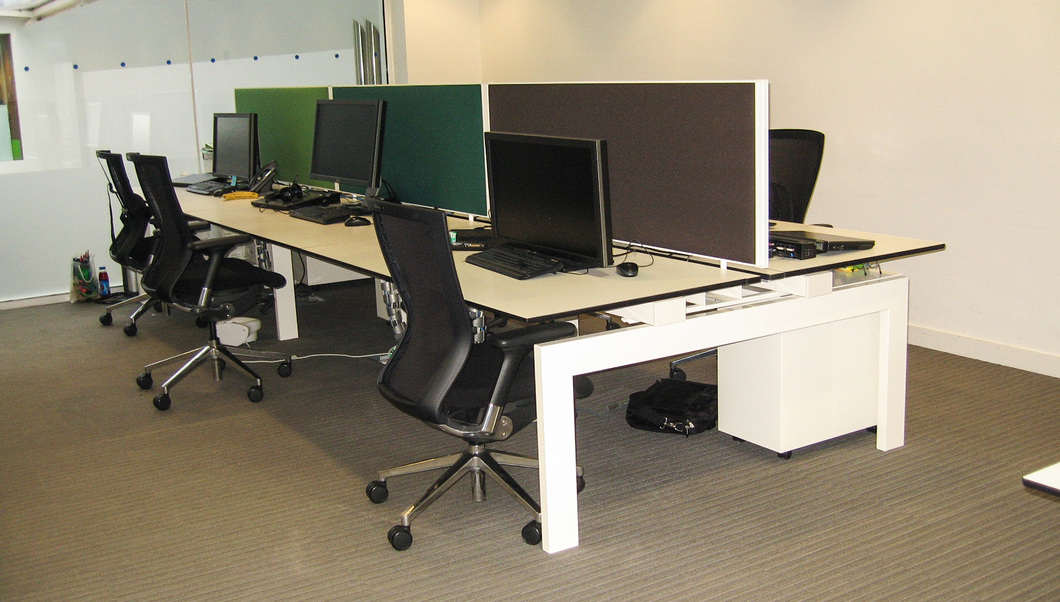 Bench desks with acoustic screens