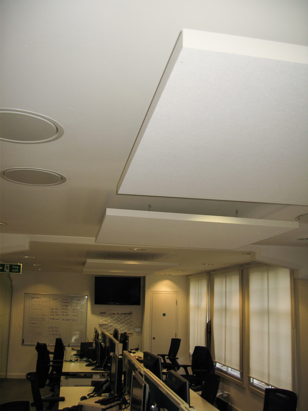 Acoustic panels below plastered ceiling