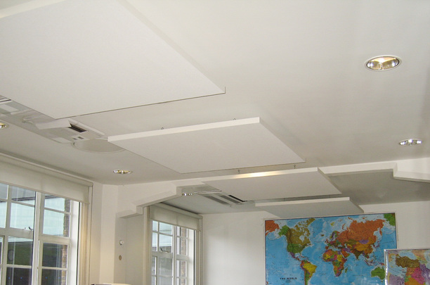 Acoustic ceiling panels fitted around lighting